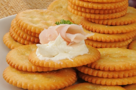 Ham and cream cheese appetizer on crackers Stock fotó
