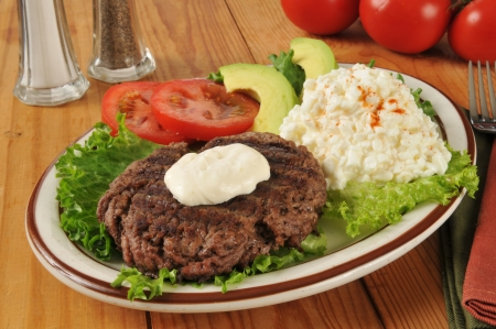 A grilled sirloin patty with cottage cheese photo