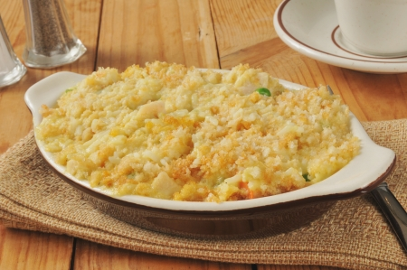 chicken rice casserole with vegetables on a rustic wooden table