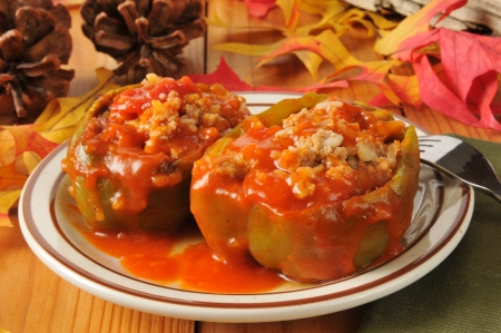 Green bell peppers stuffed with sausage, rice and tomato sauce