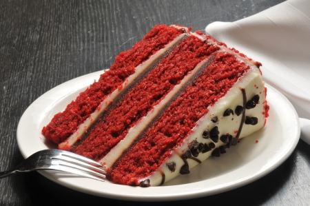 Red velvet cake with frosting and chocolate chips
