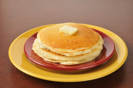 jacks: Hot buttermilk pancakes on a colorful plate and simple