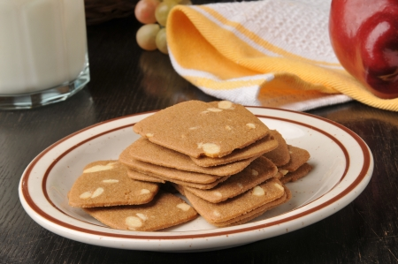 A plate of gourmet Belgian Almond Thins and an apple with milk