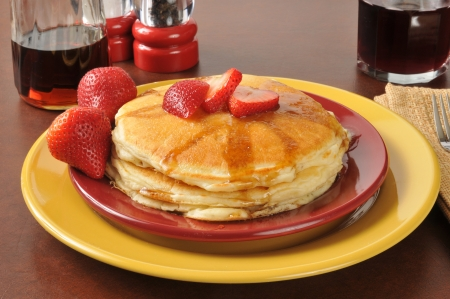 A stack of hotcakes with fresh ripe strawberries Stock Photo - 24646083