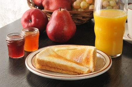 buttered: Buttered toast with jams and orange juice