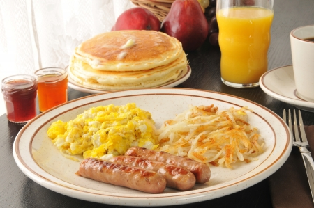 browns: Sausage and scrambled eggs with hash browns and pancakes
