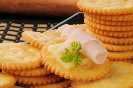 Crackers with ham and swiss cheese and a parsley garnish
