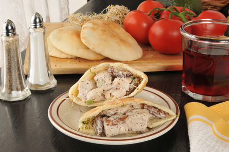 chicken salad pita pocket sandwich with fruit juice photo