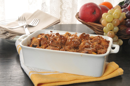 Bread pudding with caramel butterscotch sauce in a baking pan photo