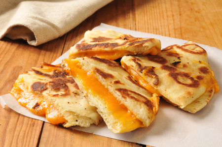 Gourmet grilled cheddar cheese sandwich on naan bread