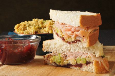 stuffing: A turkey sandwich with stuffing and cranberry sauce Stock Photo