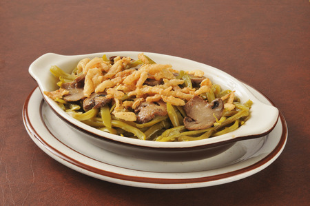 Green bean casserole with french fried onions and mushrooms