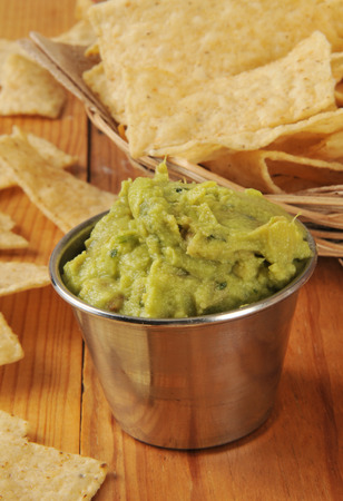 Vertical shot of guacamole dip with tortilla chips