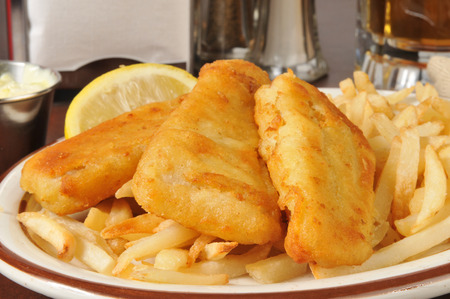 Closeup of beer battered fish sticks with french fries