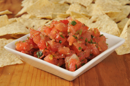 gallow: A small dish of Pico de Gallow with corn tortilla chips in the background