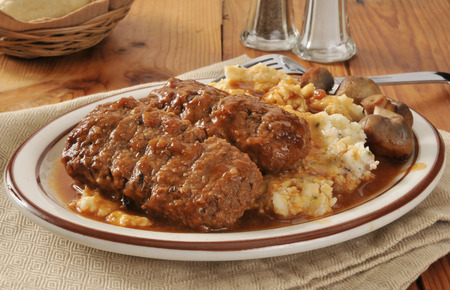 Meatloaf with mashed potatoes, gravy and sauteed mushrooms photo