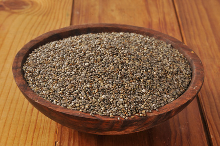 A wooden bowl of healthy Aztec Chia seeds, rich in Omega 3 and fiber