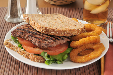 sprouted: A cube steak sandwich on sprouted whole grain and seed bread