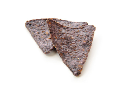 Organic blue corn tortilla chips on a white background