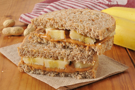 banana: a peanut butter and banana sandwich on sprouted nut and seed bread Stock Photo