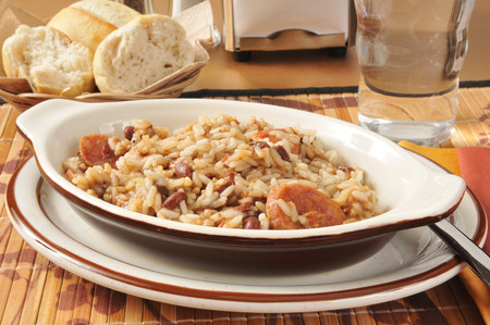 A sausage bean and rice casserole with dinner rolls