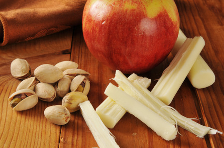 Pistachio nuts with an apple and string cheese