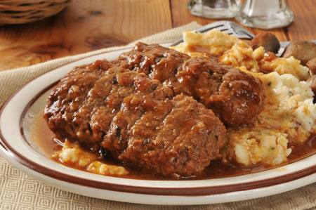 Meatloaf dinner with mashed potatoes, gravy and sauteed mushrooms photo