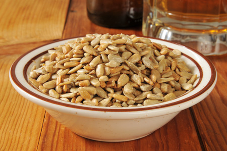 sunflower seeds: Sunflower seeds served as a bar snack with a mug of beer Stock Photo