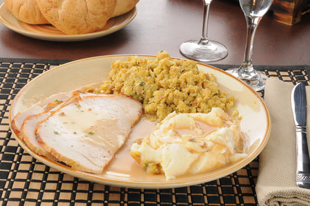 stuffing: Sliced turkey with mashed potatoes, gravy and herbal stuffing Stock Photo