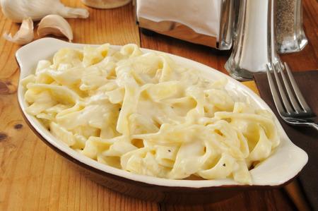 alfredo: Delicious Fettuccine Alfredo served in a small casserole dish