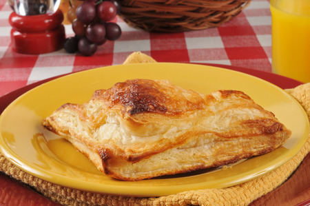 turnover: Large sugar coated apple turnover on a piate