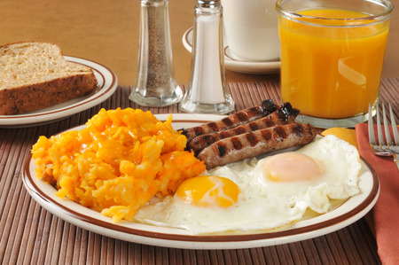 hash: Cheese hash browns with link sausage and fried eggs Stock Photo