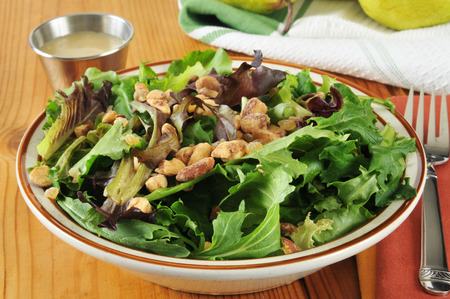 A green salad with pear gorgonzola vinaigrette and frosted almonds