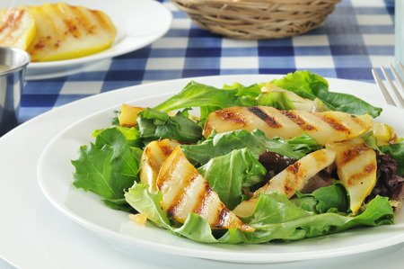 Grilled pear salad on romaine, green leaf and tango lettuce