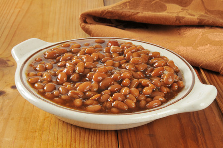A bowl of barbecue baked beans in a brown sugar sauce photo