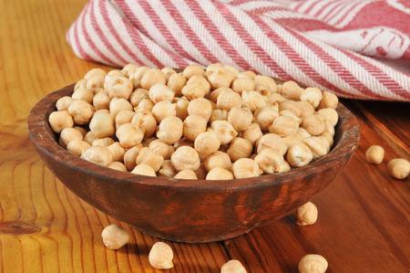 garbanzo bean: A wooden bowl of dried, organic garbanzo beans Stock Photo