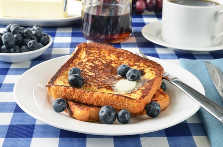 French toast with fresh blueberries on a picnic table photo