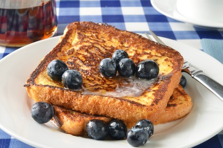 Buttered French toast with blueberries and syrup closeup photo