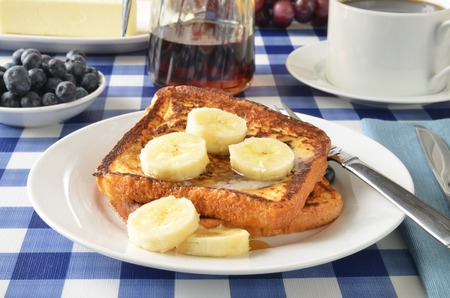 French toast with sliced bananas on a picnic table photo