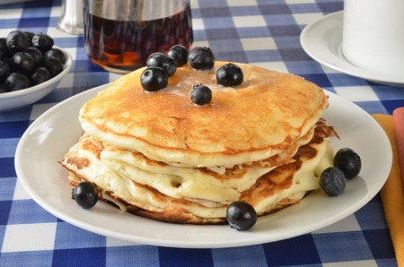 Buttermilk pancakes with blueberries on a picnic table photo