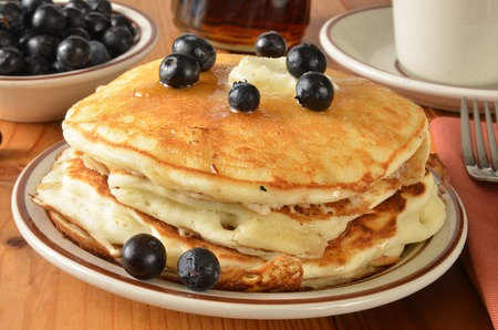 home cooked: A stack of home cooked pancakes with fresh organic blueberries