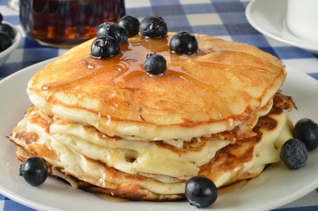 Close up of home cooked blueberry pancakes on a picnic table photo