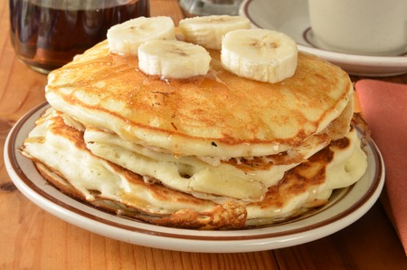 home cooked: A stack of home cooked pancakes with sliced bananas