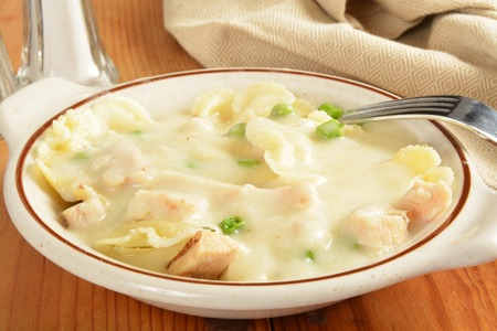 alfredo: Farafalle pasta with chicken and bacon in an alfredo sauce Stock Photo