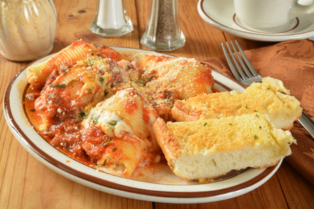 Large pasta shells stuffed with ricotta, mozzarella and parmesan cheese with a beef bolognese sauce