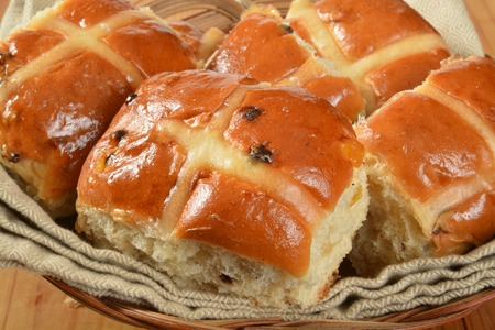 cross: A basket of hot cross buns closeup, a food associated with Good Friday Stock Photo