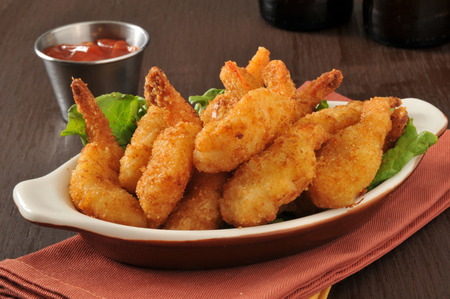 Breaded deep fried butterfly shrimp with cocktail sauce and beer