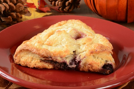 A cherry and chocolate chip turnover on a festive holiday table 版權商用圖片