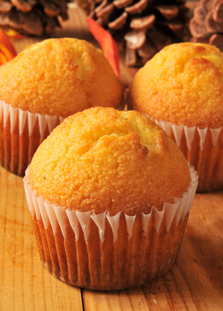 cornbread: Fresh baked cornbread muffins on a holiday table with autumn leaves and pine cones