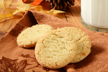 sugar: Organic, gluten free sugar cookies with milk on a holiday table